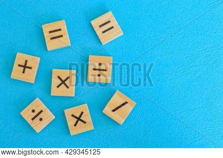 Wooden Cube Blocks With Math Symbols Or Arithmetic Symbols. Math Concept