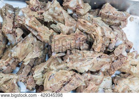 Boiled Pork With Bone On Plate. Pork Backbone Boiled To Make A Bone Soup. Fresh Pork Rib Seasoning.