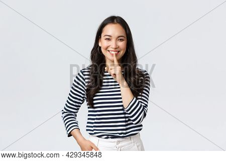 Lifestyle, People Emotions And Casual Concept. Smiling Cute Asian Girl Asking Keep Secret, Take Prom