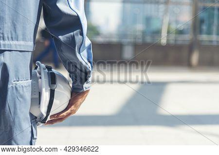 Engineer Man Hands Holding Hardhat White Work Helmet Hard Hat For Construction Engineering. Construc
