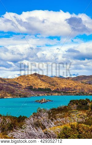 Picturesque lake Pehoe in the Patagonian Andes. Huge lake with bright azure water from melting glaciers. Travel to Chile. Cold and windy summers in the Southern Hemisphere