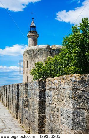 The historic tower of Constance. Antique walls of the medieval port city of Aigues-Mortes. Mediterranean coast of France. The concept of active, historical and photo tourism