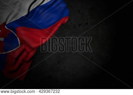 Pretty Dark Image Of Slovakia Flag With Large Folds On Black Stone With Empty Space For Your Content