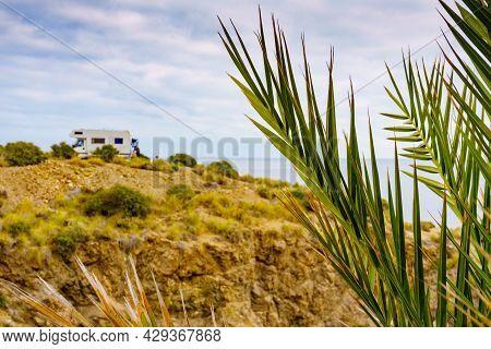 Palm Tree And Caravan Camping On Cliff Above Cala Mochuela, Spanish Landscape Along Almeria Coast. T
