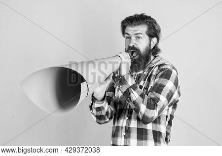 Now Hiring. Mature Guy In Checkered Shirt With Paper Megaphone. Stylish Male Use Speaker. Speak Loud