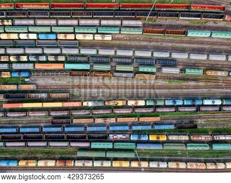 Top View On Lots Of Various Wagons: Tanks, Platforms, Dump Trucks Staying On Railways At Depot. Carg