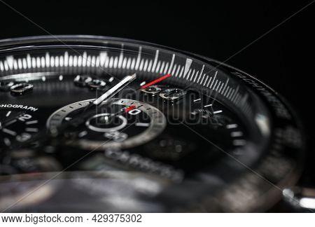 Dial Luxury Quartz Watch Chronograph On A Black Background, Close-up.