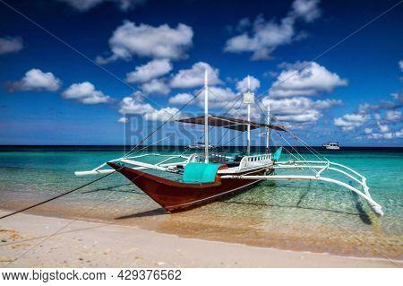 Long Tail Boat At Lombok Island. Boat Tour Around The Indonesian Island Of Lombok. Neighbor Island O