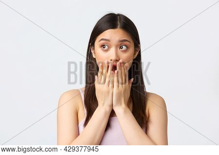 Beauty, Fashion And People Emotions Concept. Shocked Startled Asian Girl Gasping, Open Mouth And Cov