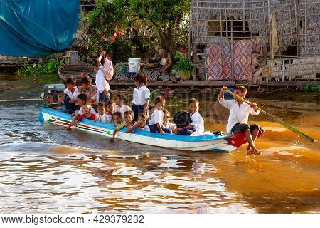 Tonle Sap Lake, Cambodia - January 04, 2017: Students On A Full Boat Return Home After School. About