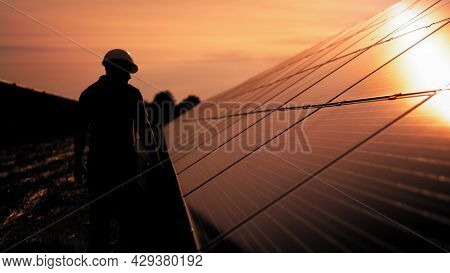 Assistance Technical Worker In Uniform Is Checking An Operation And Efficiency Performance Of Photov