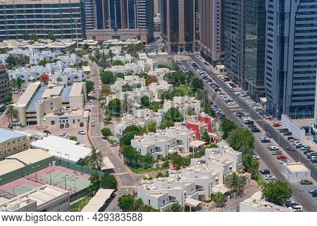 A Luxurious Villas Residential Area Of Abu Dhabi Next To Corniche , With Modern Tower Blocks In The