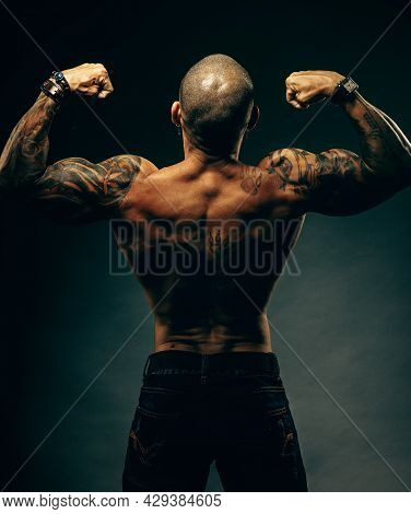 Studio Portrait Of A Muscular African American Or Latino With A Naked Torso. Male Strength And Poten