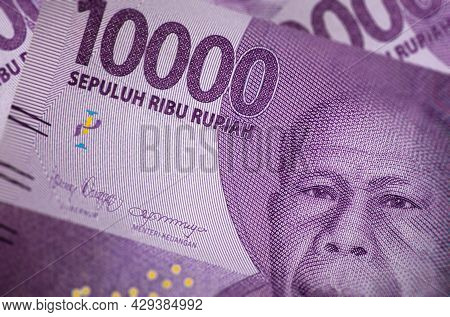 Close Up Of Indonesian Banknote. Rupiah Is The Indonesian Currency. Here A Bunch Of 10000 Rupiah. Th