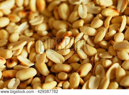 Close-up of fired salt peanuts that peeled and ready to eat, top view