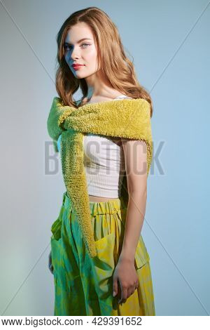 Beautiful fashion model girl poses in stylish summer clothes. Studio portrait. Fashion shot. Romantic summer style.