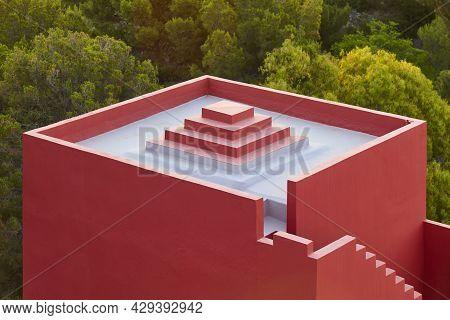 Geometric Building Construction. The Red Wall, La Manzanera. Calpe, Spain