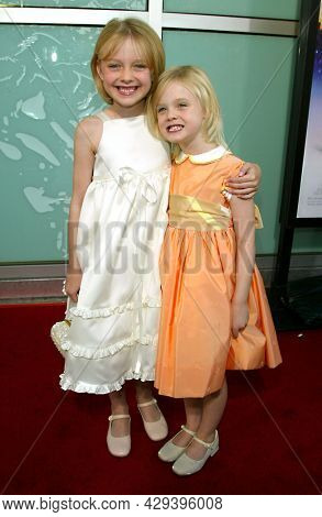 LOS ANGELES - AUG 04: Dakota Fanning and Elle Fanning arrives for the 'Uptown Girls' LA Premiere on August 04, 2003 in Hollywood, CA
