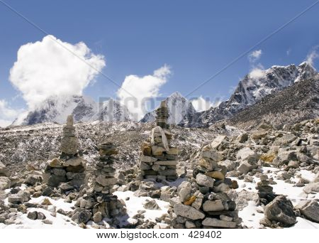 buddhist mani stone piles near the summit if kala patthar near gorak shep. poster