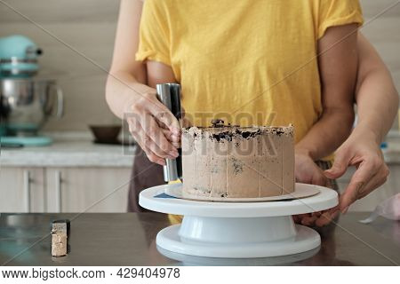 Women Couple Making Chocolate Cake In Kitchen, Close-up. Cake Making Process, Selective Focus