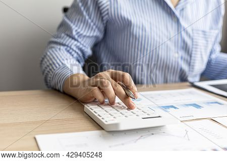 Female Auditor Pressing White Calculator, She Is A Private Company Auditor, She Is Reviewing Numbers