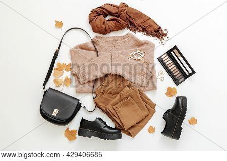 Set Female Autumn Clothing On White Background. Stylish Woman Outfit In Trendy Brown Earthy Color Wi