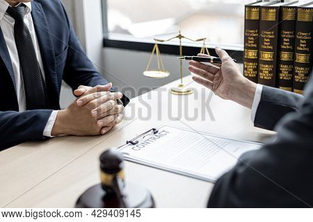 Client Was Listening To A Lawyer Advising On An Embezzlement Case, Explaining The Details Of The Pro