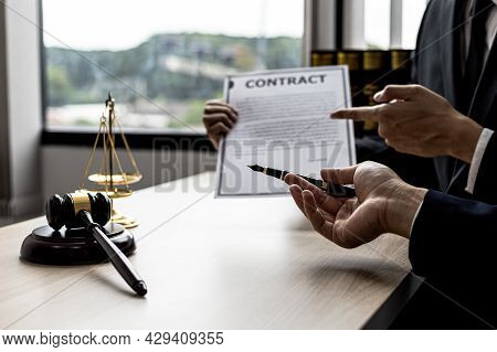 Two Male Lawyers Are Consulting Together To Draft A Contract Acknowledgment For Their Clients, They