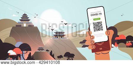Hand Holding Digital Vaccinate Certificate And Global Immunity Passport Coronavirus Immunity Concept