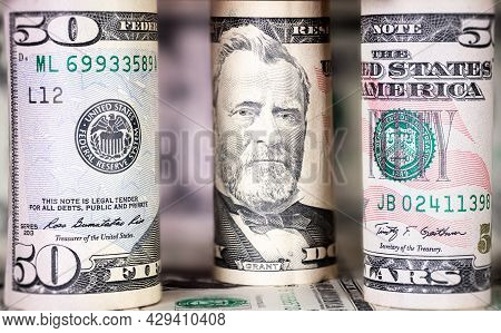 Close Up To Rolled Up 50 Us Dollar . Macro Photography Of Rolled Us Banknotes. In The Background Fur