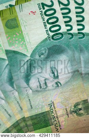 Close Up Of Indonesian Banknote. Rupih Is The Indonesian Currency. Here A Bunch Of 20000 Rupiah. The