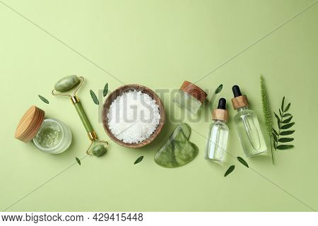 Skin Care Beauty Concept With Face Roller On Green Background