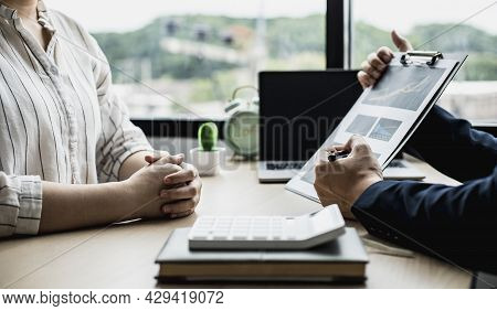 Two Businessmen Are Meeting Together On The Topic Of Monthly Finance, Financial Documents Prepared B