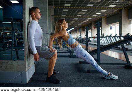 Fit couple doing exercise, fitness training