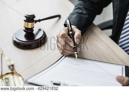 Attorney At Work, On The Table There Is A Small Hammer To Beat The Judges Table In Court. And Justic