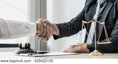 Lawyer And Client Shake Hands, After Winning A Lawsuit Where A Lawyer Hired By A Client In A Fraud C