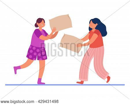 Happy Girls Fighting With Pillows. Flat Vector Illustration. Two Female Characters Having Fun In Paj