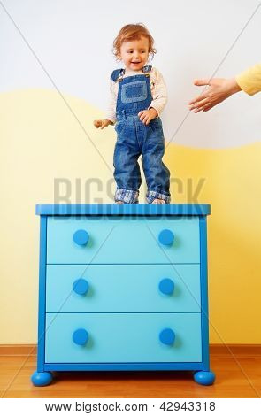 Kid Jumping From The Cabinet