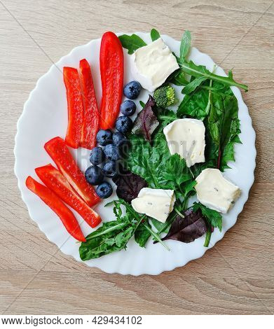 Fresh Colorful Breakfast With Blueberries, Green And Red Vegetables And Cambazzola Cheese