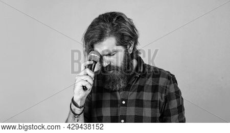 Feel Sad. Brutal Caucasian Guy With Microphone. Bearded Man. Concept Of Music. He Is Rock Star. Brut