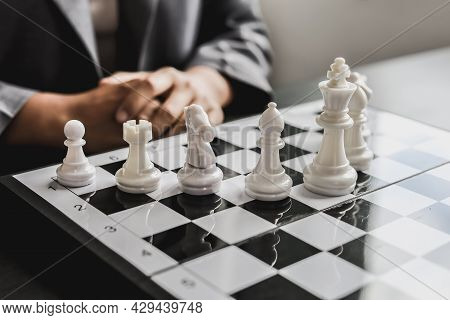 White Chess Pictures Laid Out On A Chessboard, Concept Comparing Playing Chessboard To Business Admi