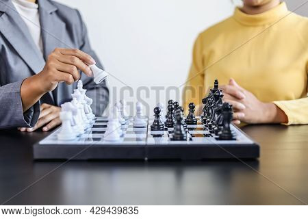 Two Business Women Competitors Playing Chess Board Game, Business Competition Concept, Business Plan