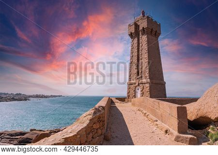 Sunset At The Mean Ruz Lighthouse Is A Building Built In Pink Granite, Port Of Ploumanach, In The To