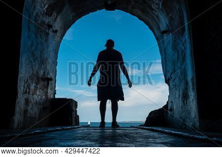 A Young Man In The Tunnel To The Sea At The Fort Des Capucins A Rocky Islet Located In The Atlantic