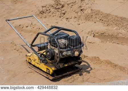 Manual Ramming Machine For Compacting Soil. Pebble Construction Machine On The Construction Site. Sa