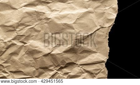 Ripped Craft Paper. Torn Kraft Paper Texture Background. Old Craft Vintage Cardboard Isolated On Bla