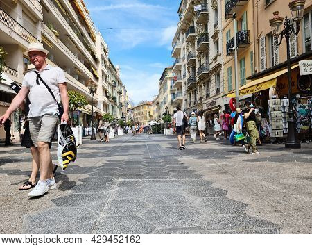 Nice, France - August 3, 2021: People And Tourists Walking In The Tourist Pedestrian Street Rue De F