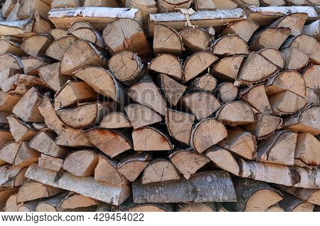 Neatly Stacked Firewood. Firewood Background. Wooden Texture.