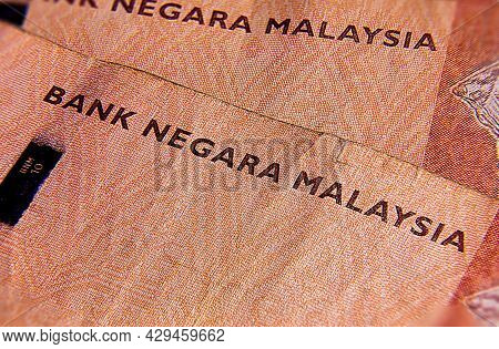 Macro Close Up Of 10 Malaysian Ringgit. Extreme Close Up Of Rm10 Malaysia. Portrait Of The First Kin