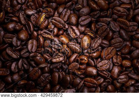 Close Up To A Heap Of Coffee Beans. Macro Photography Of Fresh Roasted Coffee Beans High Resolution.